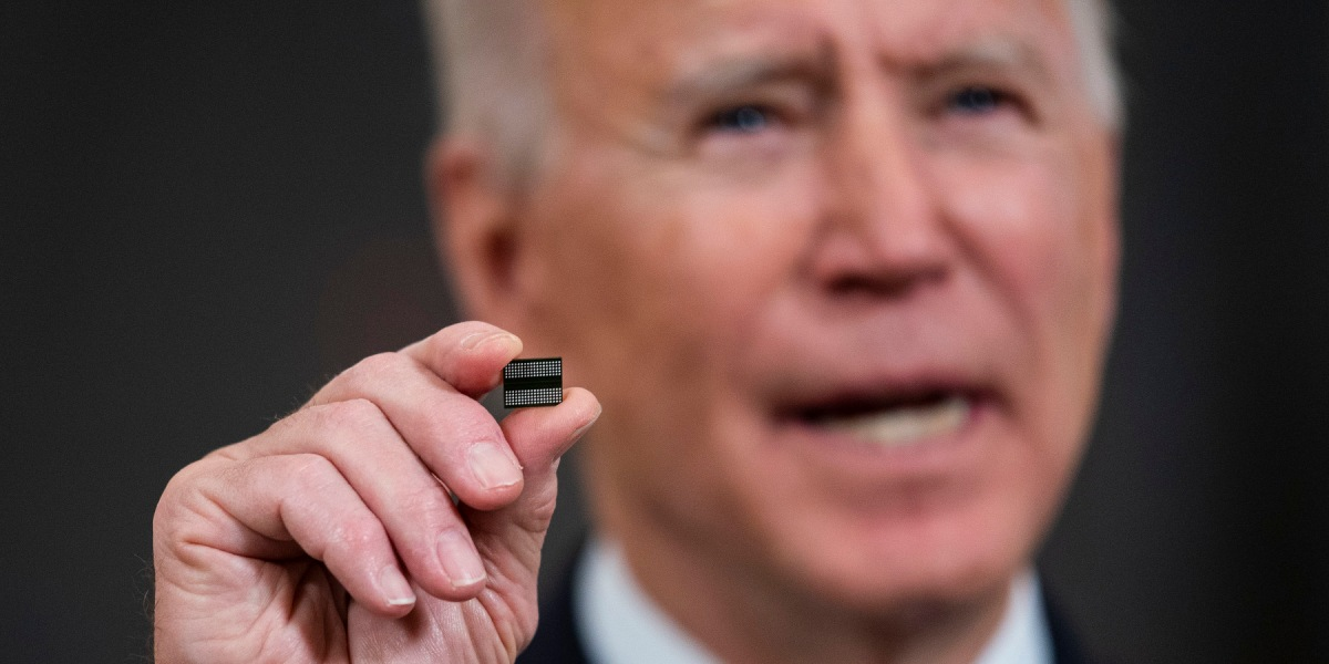 U.S. President Joe Biden holds a semiconductor during his remarks before signing an executive order on the economy in the State Dining Room of the White House on February 24, 2021 in Washington, DC.