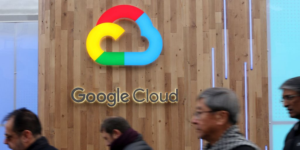 DAVOS, SWITZERLAND - JANUARY 25:  Pedestrians pass a Google Cloud logo on January 25, 2018 in Davos, Switzerland. The Google Cloud Platform is a set of cloud computing services that includes online management tools to manage data storage, data analytics and other services.  (Photo by Adam Berry/Getty Images)