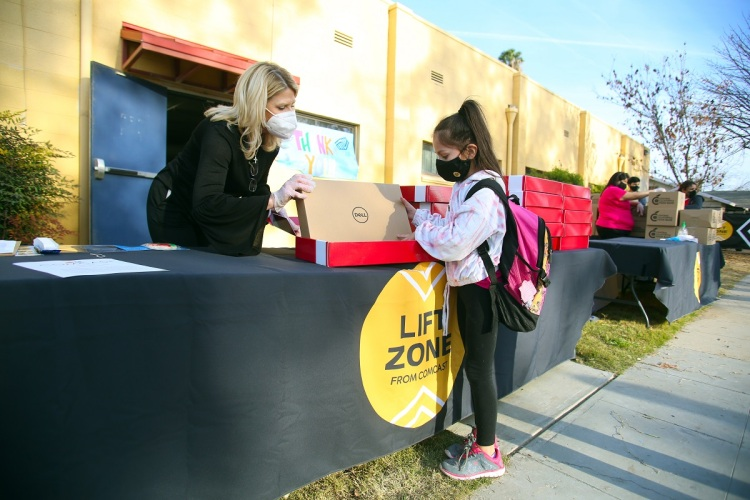 Comcast Internet Essentials, Central Valley Lift Zones announcement, where families received a laptop, 12 months of internet and a box of food items at the Boys and Girls Clubs of Fresno County on Tuesday Dec 12, 2020 in Fresno, Calif.
