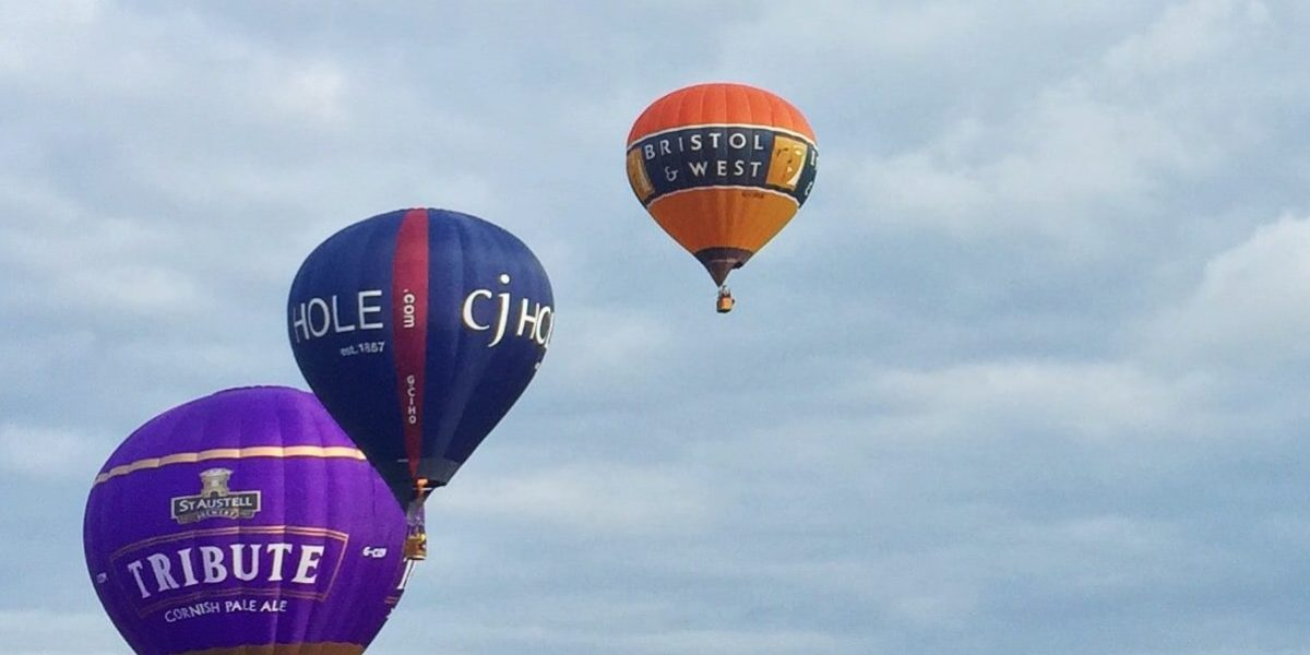 Hot air balloons flying into the sky as part of a race