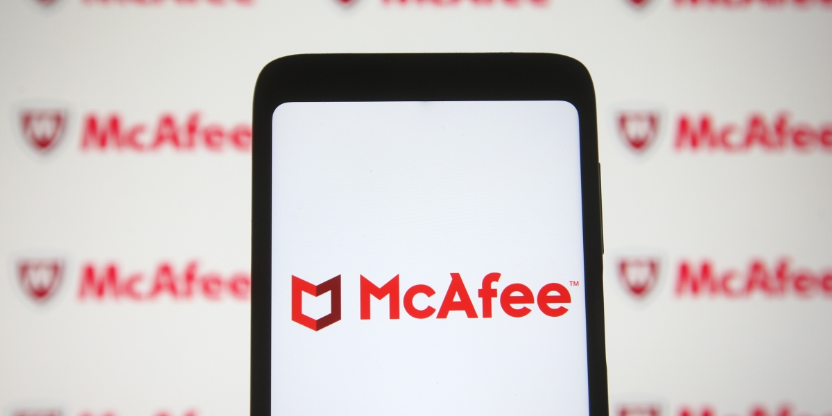 McAfee logo seen on a smartphone and a pc screen.