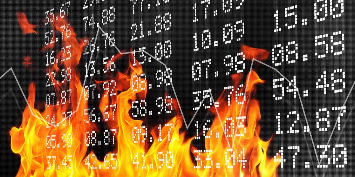 Fire burning up a wall of numbers