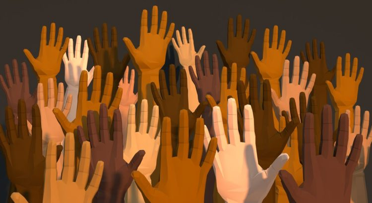 A series of brown, black, and white hands reaching upwards.