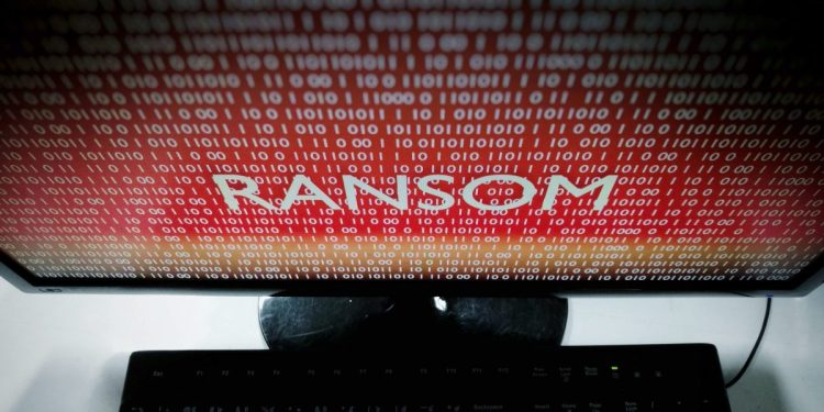 An image of a red computer screen with the words RANSOM written on it.
