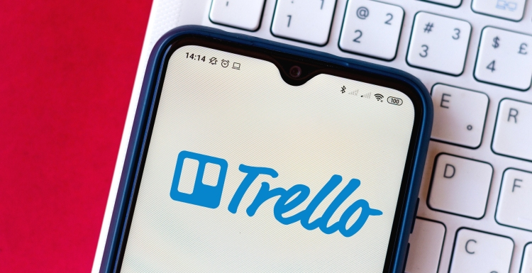 Illustration the Trello logo seen displayed on a smartphone