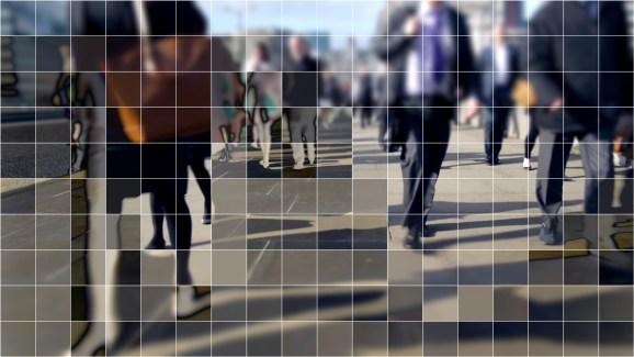 People walking on a public street, with a cubist digital grid effect.