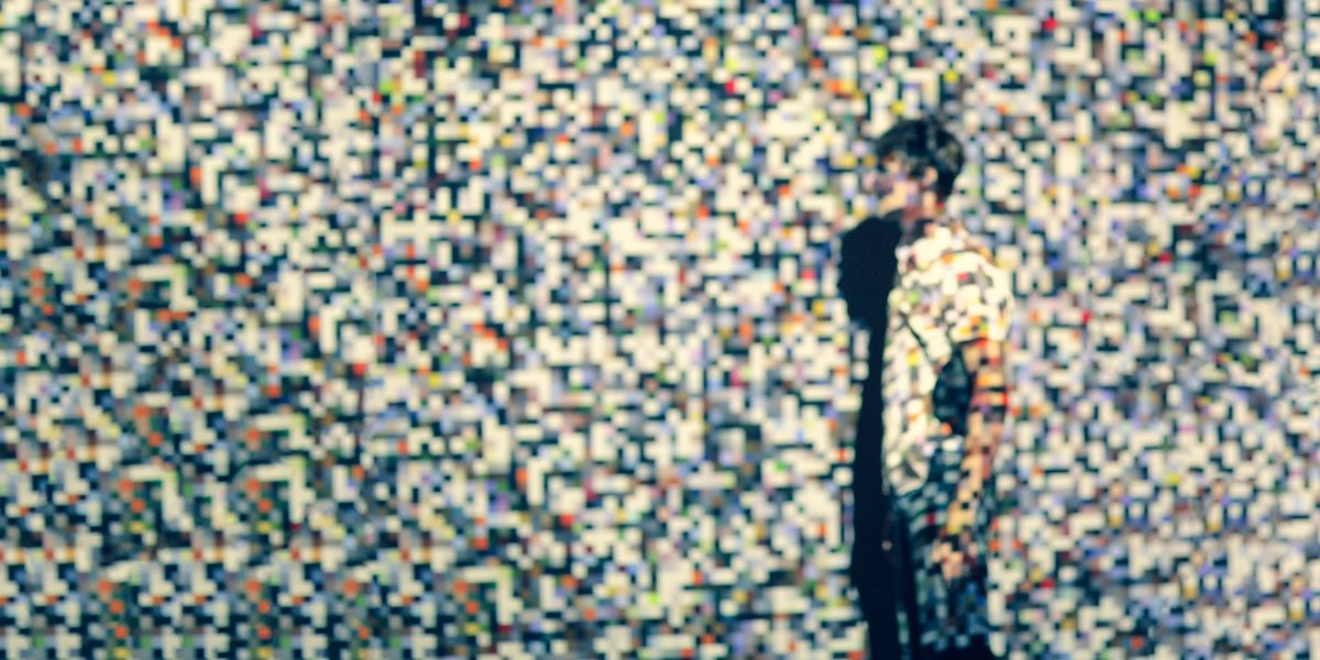 A person projected in pixels.