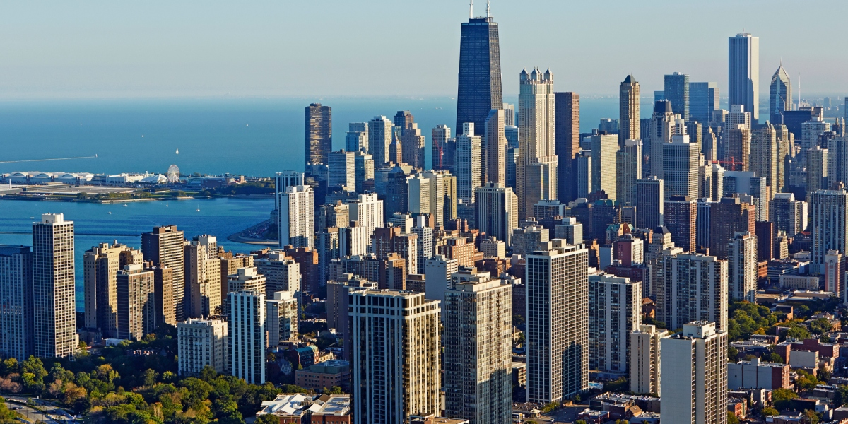 Aerial panoramic cityscape of Downtown Chicago with the shoreline of Lake Michigan.