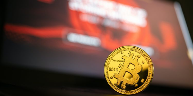 Cryptocurrency against a computer screen