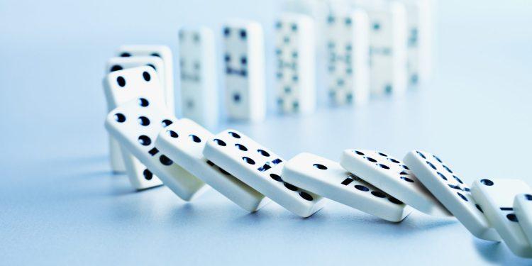 pile of dominoes falling
