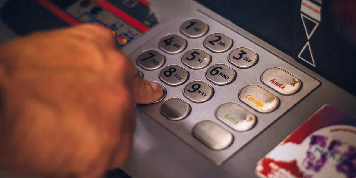 Using a ATM - Hand pressing number
