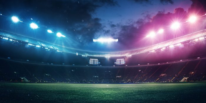 Full stadium and neoned colorful flashlights background. Flyer with copyspace in modern colors. Concept of sport, competition, winning, action and motion. Empty area for championships, your ad, design.