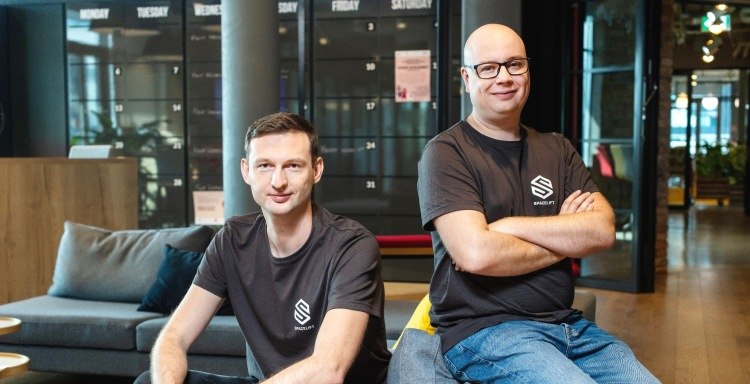 Spacelift COO Paweł Hytry and CEO Marcin Wyszynski, pose in company t-shirts.